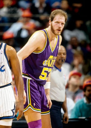 Then-Utah Jazz center Mark Eaton in action against the Orlando Magic at the Orlando Arena in 1991.
