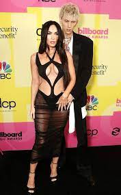 Megan Fox used social media to add a dash of reality after she and Machine Gun Kelly stole the red carpet with their steamy PDA during the 2021 Billboard Music Awards on May 23.