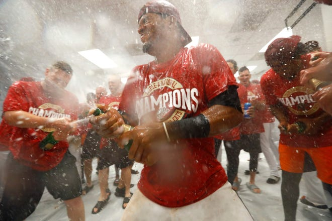 The Sacramento River Cats celebrate their Triple-A National Championship after defeating the Columbus Clippers 4-0 at AutoZone Park in Memphis.