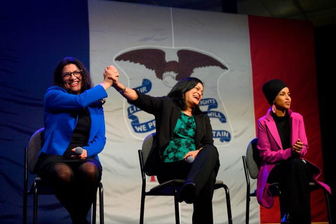 Rep. Rashida Tlaib (L), D-Mich., high-fives Rep. Pramila Jayapal, D-Wash., with Rep. Ilhan Omar, D-Minn in an undated photo taken at an event for supporters of Sen. Bernie Sanders of Vermont.