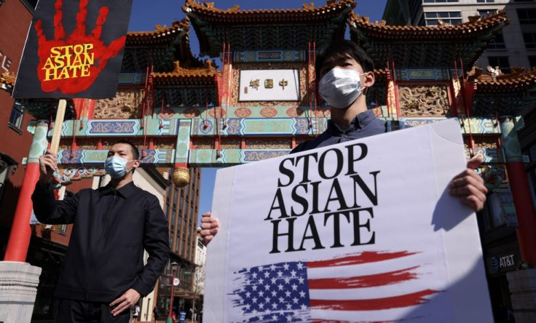 Leon Zhang, left, and Chris Tang of McLean, Va.,  march in a rally to promote protection for Asian American communities March 21 in Washington.