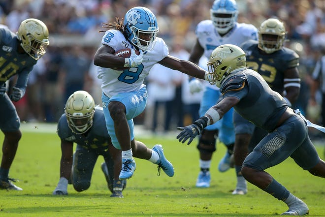 North Carolina Tar Heels running back Michael Carter (8) runs the ball against the Georgia Tech Yellow Jackets in the first half at Bobby Dodd Stadium