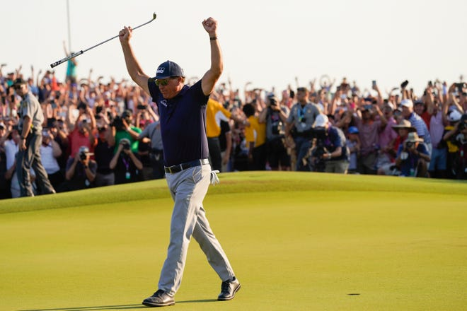 Phil Mickelson celebrates after winning the PGA Championship.