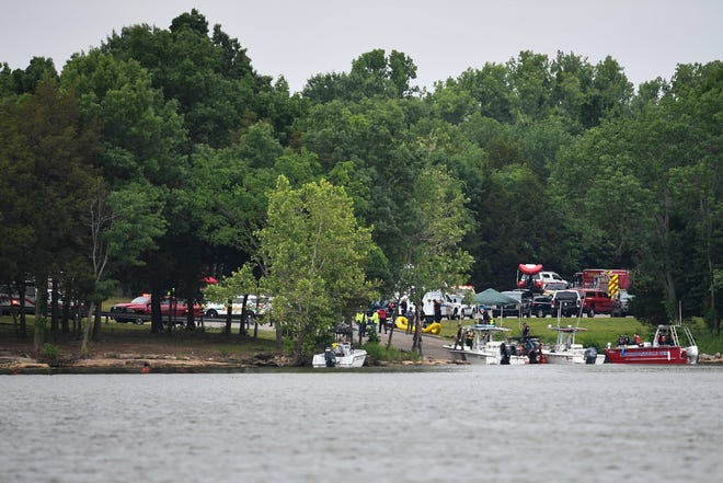 Emergency personnel stage at the Fate Sanders boat ramp on J. Percy Priest Lake to search for a small plane crash Saturday, May 29, 2021 in Smyrna, Tenn.