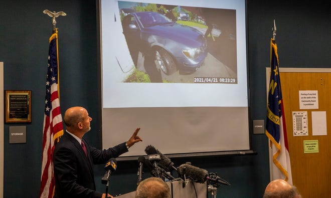 Pasquotank County District Attorney Andrew Womble shows still images from police body camera footage at a news conference May 18 in Elizabeth City, N.C., after announcing he will not charge deputies in the fatal shooting of Andrew Brown Jr. on April 21.