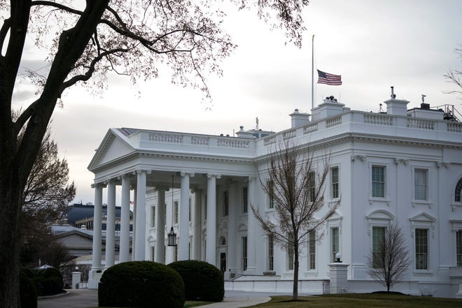 The American flag flies at half-staff at the White House on March 19, 2021 in Washington, DC.