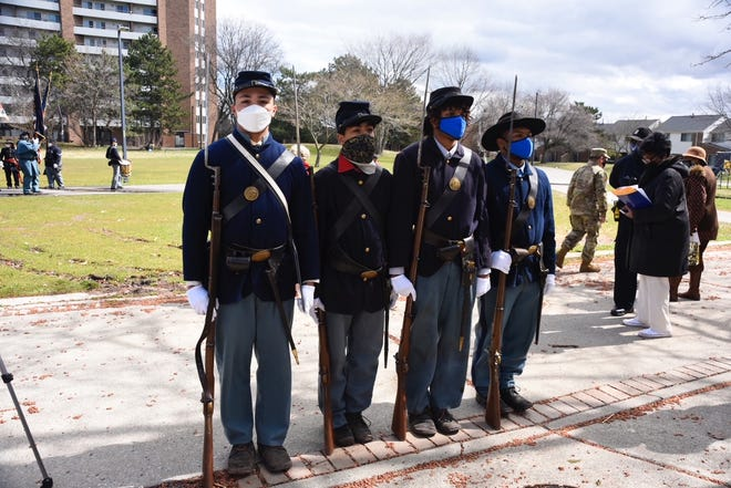 Members of the 102nd U.S. Colored Troops Company C reenactment group. The group is located in Jackson, Michigan, and is comprised of only high school students.