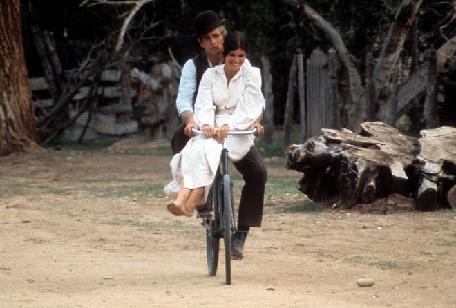 """The visual that sparked """"Raindrops Keep Fallin' on My Head"""": Paul Newman and Katharine Ross double up on a bicycle in 1969's """"Butch Cassidy and the Sundance Kid."""""""
