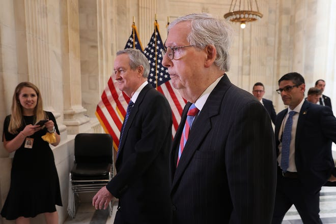 Senate Minority Leader Mitch McConnell, R-Ky., right, and Sen. Mike Crapo, R-Idaho, leave a Senate Republican Policy Committee closed-door luncheon in the Russell Senate Office Building on Capitol Hill on May 27, 2021 in Washington, D.C.