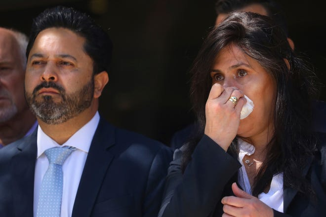 Santa Clara Valley Transportation Authority member Magdalena Carrasco, right, wipes away tears during a news conference honoring nine colleagues killed by a coworker on Thursday, May 27, 2021, in San Jose, Calif.