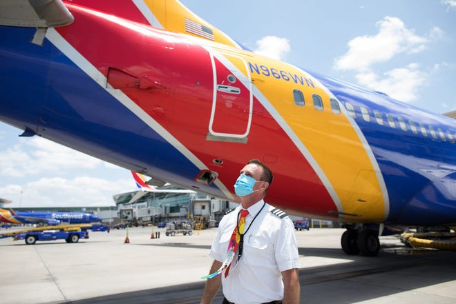 A Southwest Airlines pilot outside one of the airplane's Boeing 737s.