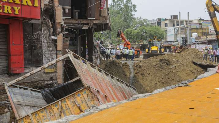 cyclone tauktae, Truck, fall, caved road, heavy rainfall, Delhi, aftermath, metro station, national