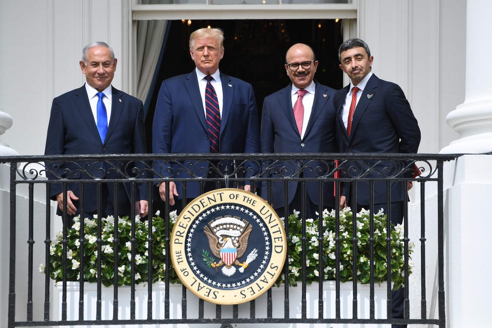 Israel Prime Minister Benjamin Netanyahu, President Donald Trump, Bahrain Foreign Minister Abdullatif al-Zayani, and United Arab Emirates Foreign Minister Abdullah bin Zayed Al-Nahyan pose from the Truman Balcony at the White House after they participated in the signing of the Abraham Accords.