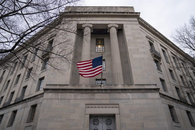 WASHINGTON, DC - FEBRUARY 19: The Department of Justice headquarters stands on February 19, 2020 in Washington, DC. A Department of Justice spokesperson is denying that Attorney General William Barr is considering resigning after his critical comments about President Trump Trump tweeting about ongoing Department of Justice cases. (Photo by Drew Angerer/Getty Images) ORG XMIT: 775481664 ORIG FILE ID: 1201922029