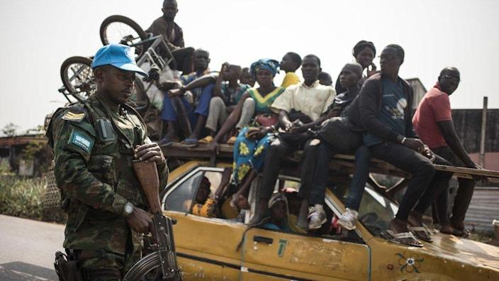 A Rwandan peace-keeper from the United Nations Multidimensional Integrated Stabilization Mission in the Central African Republic (MINUSCA) patrols the road leading to Damara, where skirmishes took place during the week on January 23, 2021