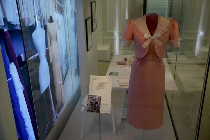 India Tv - A dress and jacket that Princess Diana changed into on her wedding day made by designer David Sassoon is displayed during a media preview for the