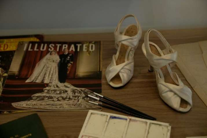 India Tv - Prototype shoes for the ones Britain's Queen Elizabeth II wore at her wedding are displayed during a media preview for the