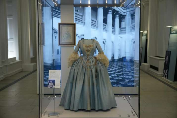 India Tv - A Georgian style dress worn by Princess Margaret, the sister of Britain's Queen Elizabeth II, to a charity costume ball in 1964 and created by theatre designer Oliver Messel is displayed during a media preview for the