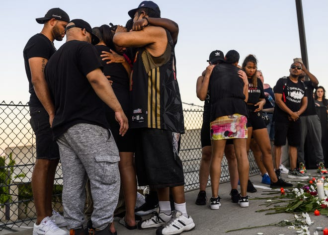 Friends and family embrace during a vigil at the site where Winston Boogie Smith was killed on June 4, 2021 in Minneapolis, Minnesota. Smith was shot and killed yesterday during an altercation with law enforcement involving multiple agencies. Smith's family is demanding clarity in the case as authorities claim there is no video available from the incident.