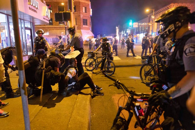 Protesters are arrested by police after a vigil was held for Winston Boogie Smith Jr. early on Saturday, June 5, 2021. Authorities said Friday that a man wanted on a weapons violation fired a gun before deputies fatally shot him in Minneapolis, a city on edge since George Floyd's death more than a year ago under an officer's knee and the more recent fatal police shooting of Daunte Wright in a nearby suburb.