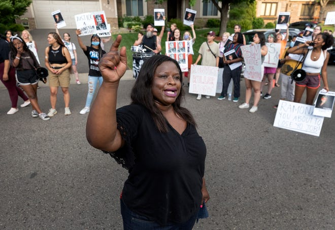 Nekima Levy Armstrong and other protesters demonstrate outside of the home of U.S. Marshal Ramona Dohman on June 8, 2021, in Minneapolis, in protest of the fatal shooting of Winston Boogie Smith Jr.