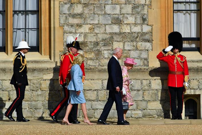 The Bidens walk next to the Queen at Windsor Castle.