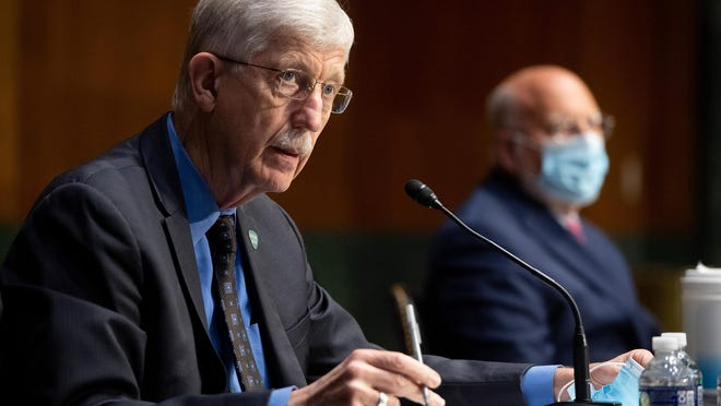 Dr. Francis Collins, left, director of the National Institutes of Health, and Dr. Robert Redfield, then the director of the Centers for Disease Control and Prevention, testify in 2020 on Capitol Hill.
