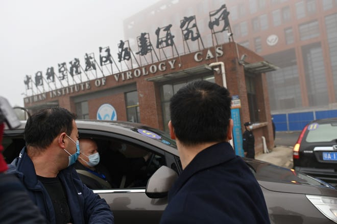Members of the World Health Organization team investigating the origins of the COVID-19 virus arrive at the Wuhan Institute of Virology in  February 2021.
