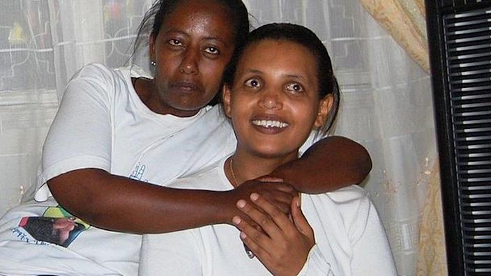 Ethiopian opposition leader Birtukan Mideksa (R) smiles after having returned home in Addis Ababa hours after she was released from jail by Ethiopian authorities on October 6, 2010