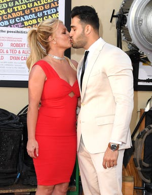 """Britney Spears and Sam Asghari arrives at the Sony Pictures' """"Once Upon A Time...In Hollywood"""" Los Angeles Premiere on July 22, 2019 in Hollywood, California."""
