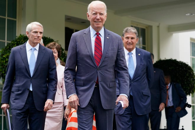 President Joe Biden, with from left, Sen. Rob Portman, R-Ohio, Sen. Susan Collins, R-Maine, and Sen. Joe Manchin, D-W.Va., and a bipartisan group of senators, walks out to speak to the media, Thursday June 24, 2021, outside the White House in Washington. Biden invited members of the group of 21 Republican and Democratic senators to discuss the infrastructure plan.