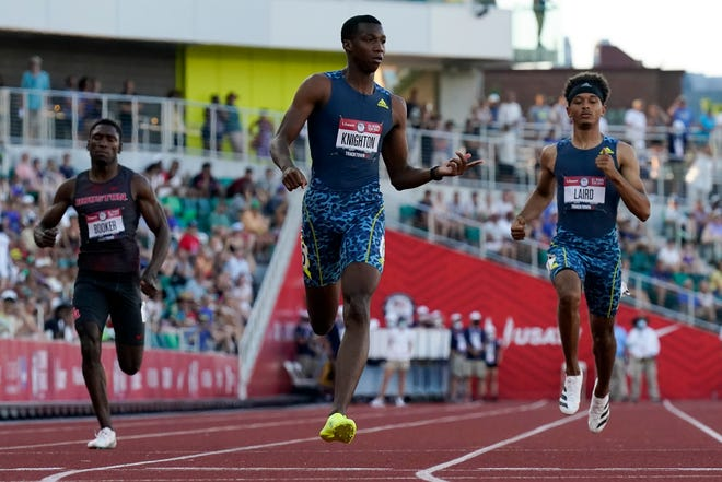 Erriyon Knighton wins a semi-final in the men's 200-meter run at the U.S. Olympic Track and Field Trials Saturday, June 26, 2021, in Eugene, Ore. (AP Photo/Ashley Landis)