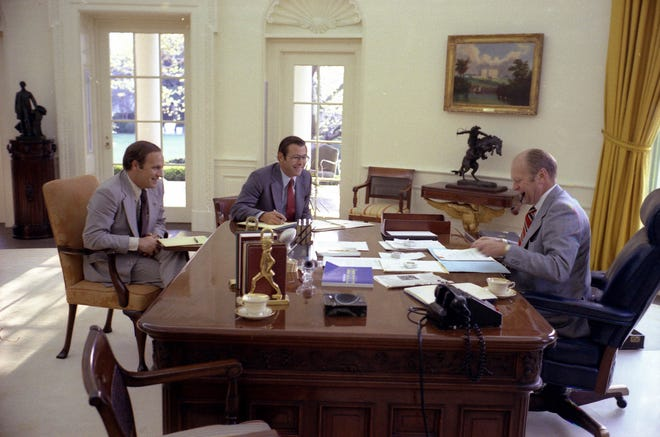 President Ford meets with chief of staff Donald Rumsfeld and Dick Cheney in the Oval Office on April 22, 1975.