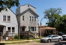 Crime scene tape hangs outside a house where multiple people were shot, some fatally, inside the Englewood building, Tuesday, June 15, 2021, in Chicago.