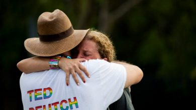 U.S. Reps. Debbie Wasserman Schultz and Ted Deutch hug after a truck drove into a crowd of people during a Pride parade in Wilton Manors near Fort Lauderdale on Saturday.