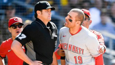 Cincinnati Reds' Joey Votto gets ejected during fan's first game, makes up for it after