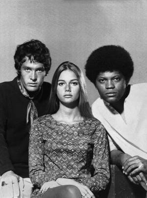 """Clarence Williams III  (far right) starred on """"The Mod Squad"""" with (L-R) Michael Cole and Peggy Lipton."""