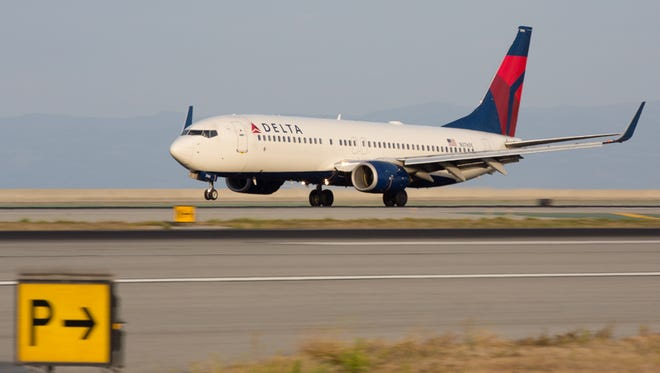 A Delta Air Lines flight from Los Angeles to Nashville diverted to Albuquerque Friday after crew members had to detain an unruly passenger. The passenger was met by airport police and the FBI is investigating. The plane was a Boeing 737-900, part of the Boeing 737 family pictured here.