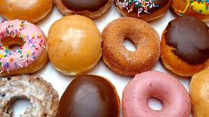 It's National Donut Day, also known as National Doughnut Day, and businesses such as Dunkin' Donuts and Krispy Kreme are celebrating with fried freebies and other promotions.