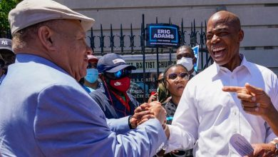 Democratic mayoral candidate Eric Adams greets supporters during a campaign event.