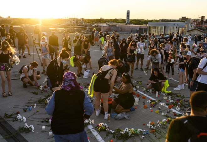 People gather for a vigil at the site where Winston Boogie Smith was killed on June 4, 2021 in Minneapolis, Minnesota. Smith was shot and killed yesterday during an altercation with law enforcement involving multiple agencies. Smith's family is demanding clarity in the case as authorities claim there is no video available from the incident.