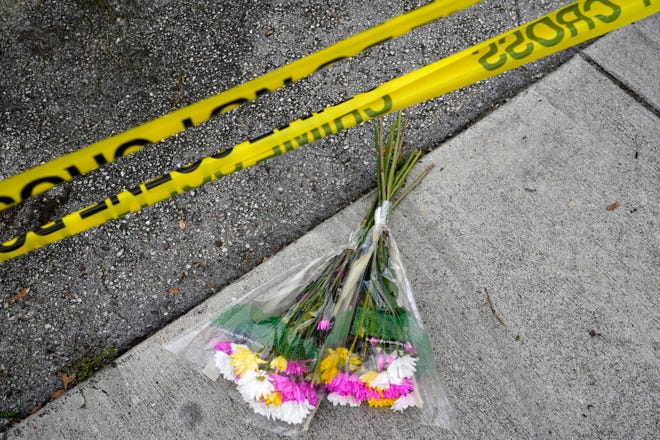 Flowers lie at the scene where a driver slammed into spectators at the start of a Pride parade Saturday evening, killing one man and seriously injuring another, Sunday, June 20, 2021, in Fort Lauderdale, Fla. Officials said the crash was an accident, but it initially drew speculation that it was a hate crime directed at the gay community. The driver and victims were all members of the Fort Lauderdale Gay Men's Chorus, who were participating in the Wilton Manors Stonewall Pride Parade.