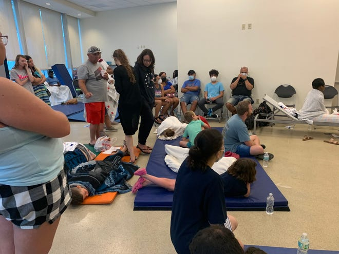 The American Red Cross set up a reunification site for family and friends near the site of the partial building collapse of a 12-story condominium early Thursday, June 24, 2021, in Surfside, Fla. About 70 people crammed into a room with chairs and blue gym mats on the floor.