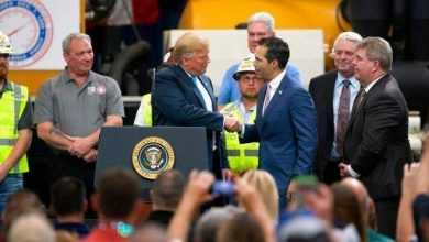 """President Donald Trump with Texas Land Commissioner George P. Bush at April 2019 event in Crosby, Texas. Trump introduced the land commissioner as """"the only Bush that likes me."""" JUAN DeLEON/ Associated Press"""