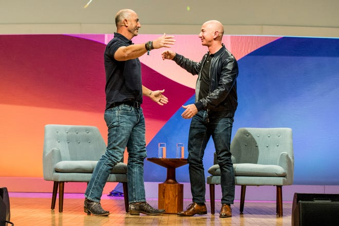 Mark Bezos, left, has worked in marketing, as an executive at the nonprofit Robin Hood Foundation and served as a volunteer firefighter.