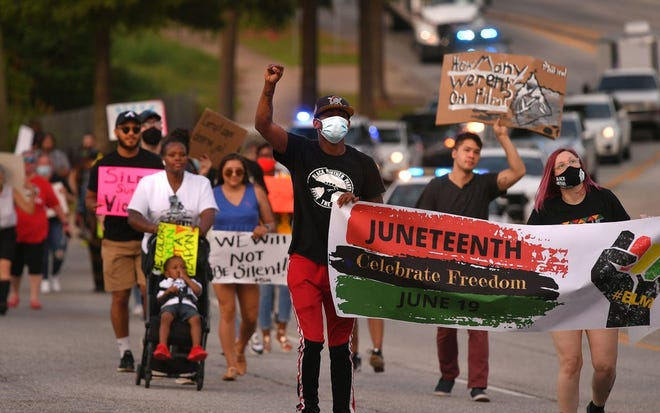 Protesters marched from John B. White, Sr. Blvd., through Spartanburg, Friday evening, June 19, 2020. The crowd marched in celebration of Juneteenth.