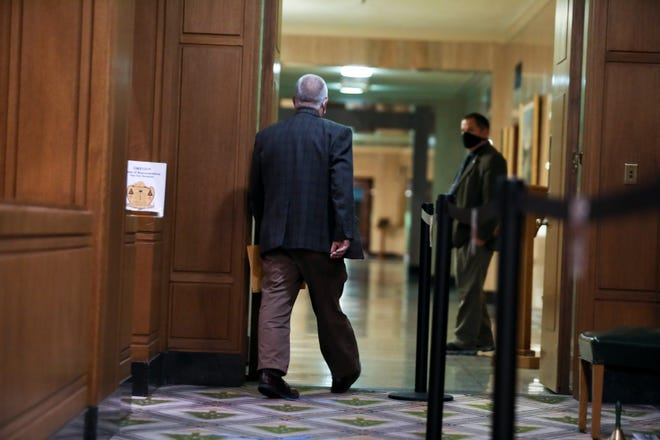 Rep. Mike Nearman leaves the House of Representatives after the vote to expel on Thursday.
