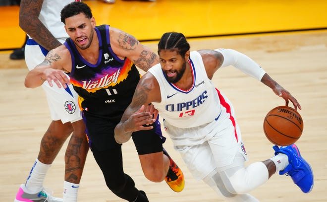 Paul George drives to the basket against the Phoenix Suns' Abdel Nader in Game 5.