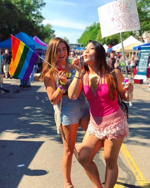 Jamie Park offered up free kisses at Lansing Pride, which she attended with her friend Brooke Hansen in 2018.