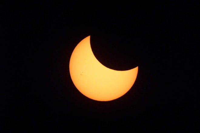 A partial eclipse of the sun appeared in the sky over New York on Christmas Day 2000.